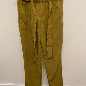Camel coloured pants with a waist tie.